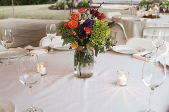 events-tent-table-floral-centerpiece